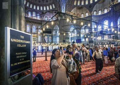 Tourist Taking Photos in the Blue Mosque, Istanbul, Turkey